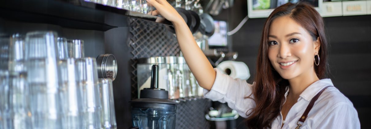 A young woman in her new coffee shop business